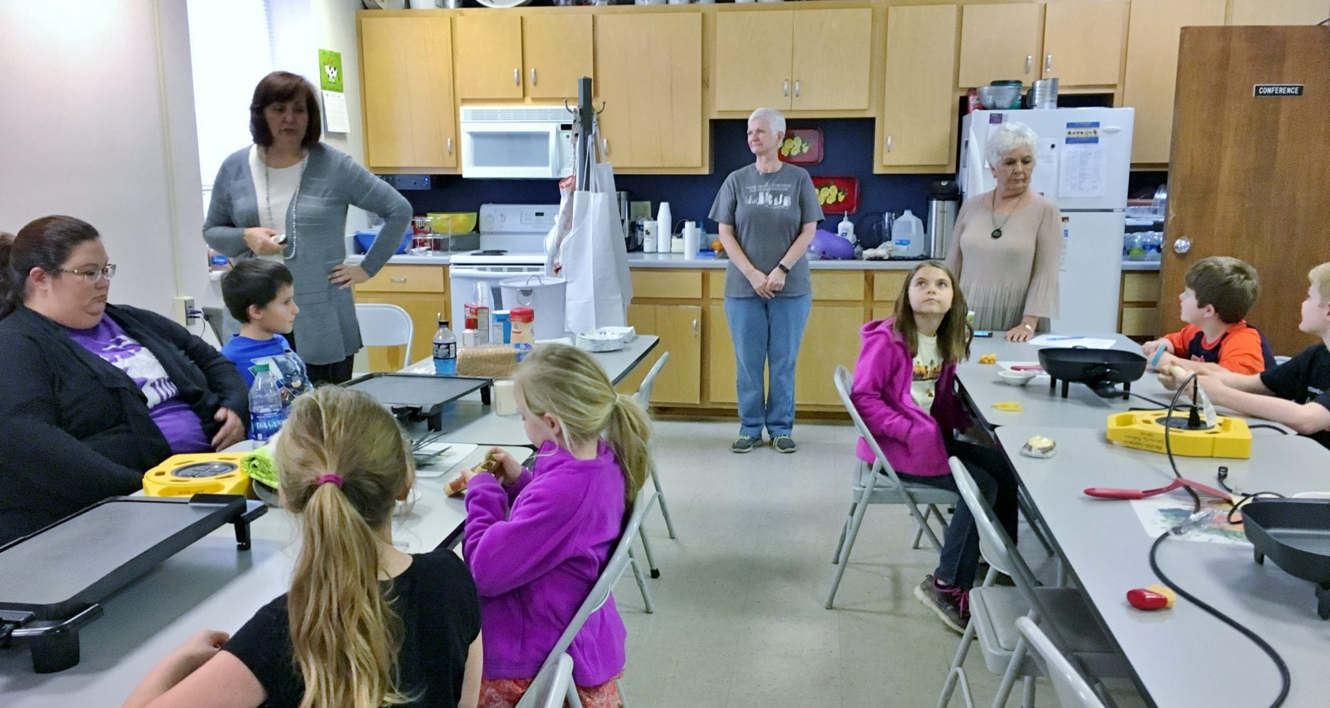 Interns helping with Chef 4-H program