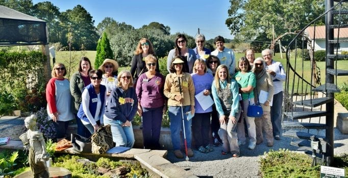 group of master gardeners touring Demo Garden
