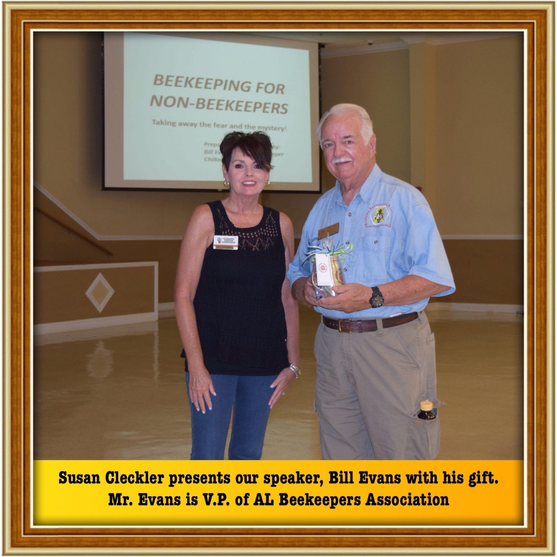 MG V.P. Gives gift to speaker
