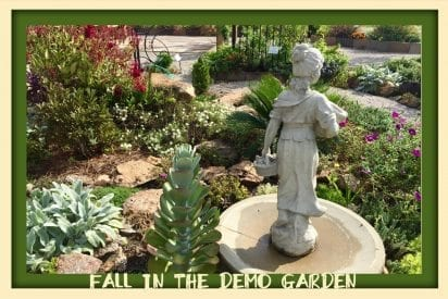 Statue in garden with rocks and low growing plants