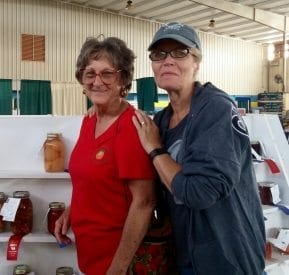 Master Gardeners judging canned goods at fair.
