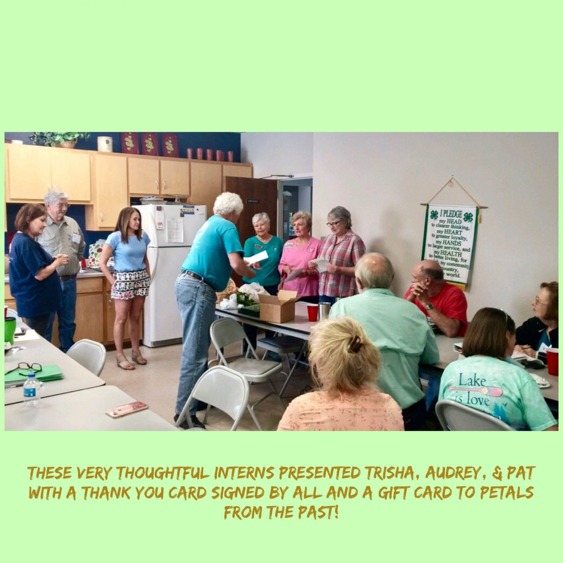 Facilitators receiving a thank you gift